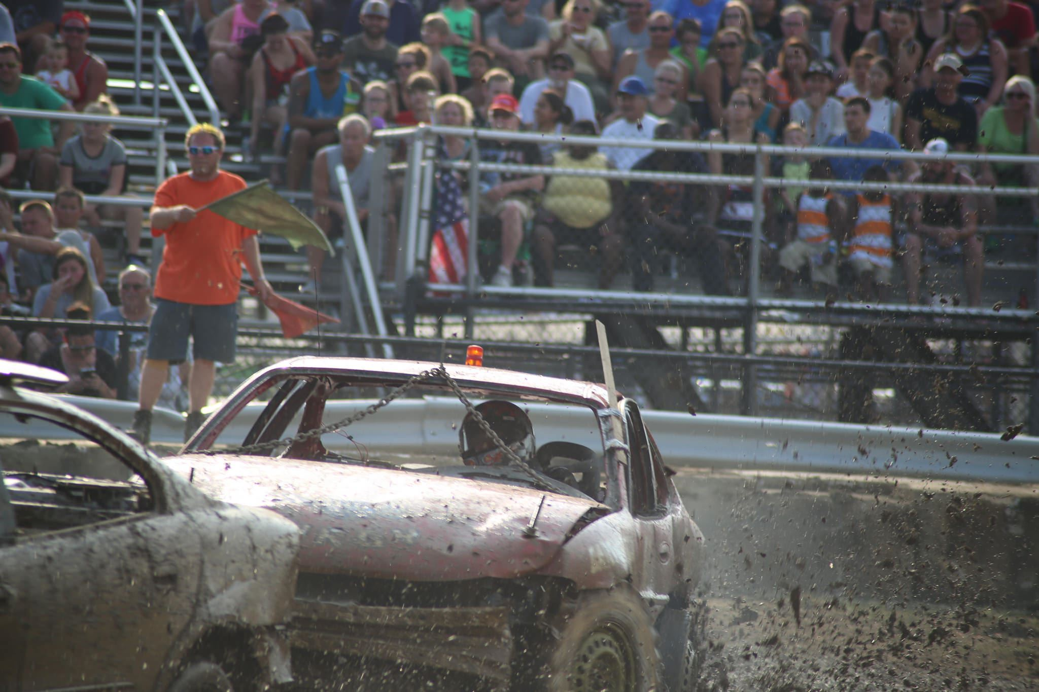 Cars smashing into each other at Demolition Derby